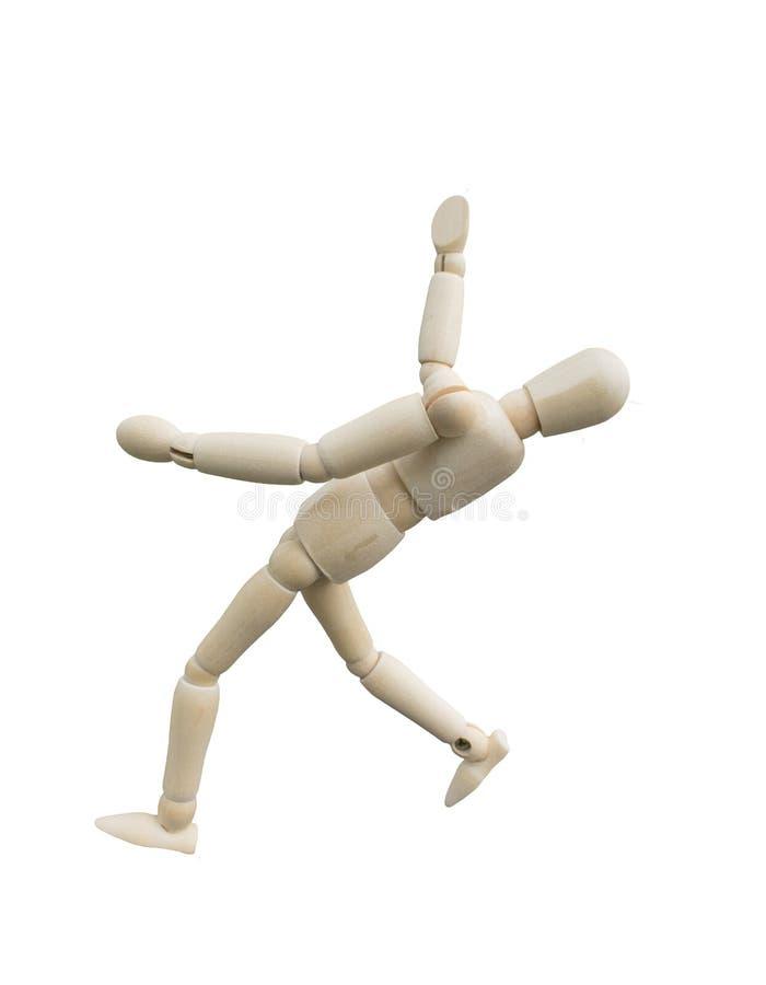Concept en baisse d'accidents Acte en bois de marionnette comme le glissement en bas du plancher sur le fond blanc images libres de droits