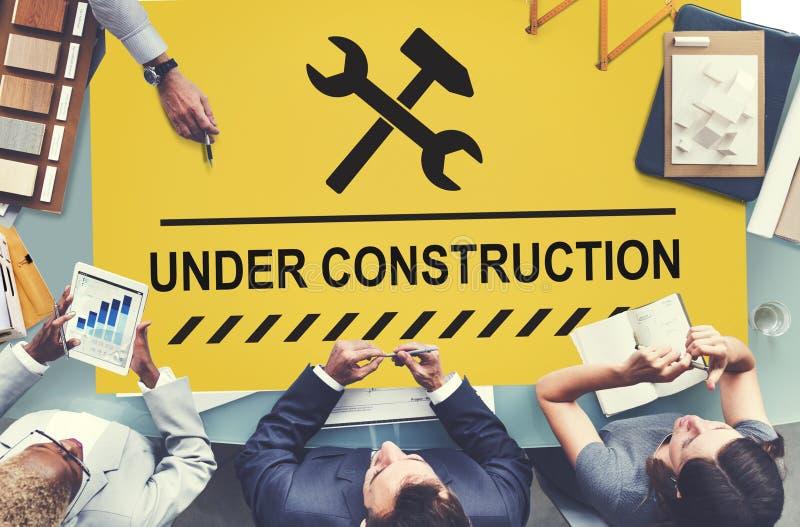 Concept en construction d'icône de panneau d'avertissement image libre de droits