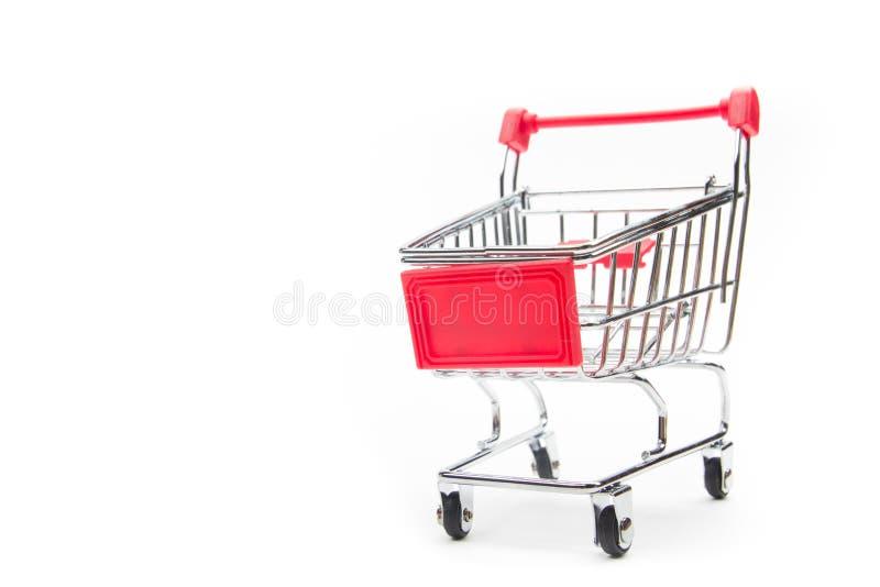 Concept en ligne d'achats - caddie, ordinateur portable et PC vides de comprimé, smartphone d'isolement sur le fond blanc Copiez  photo libre de droits