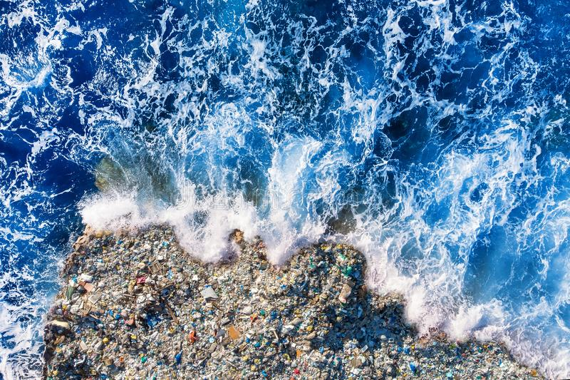 Concept environmental pollution ocean and water with plastic and human waste. Aerial top view.  stock photography