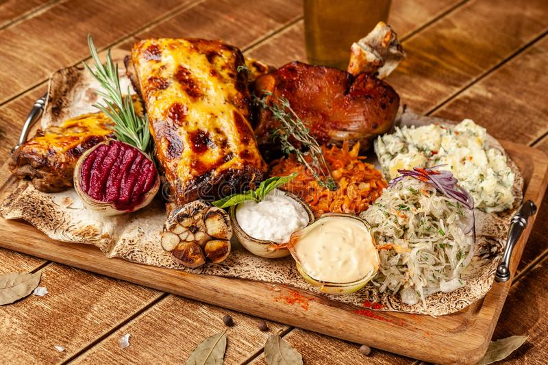 The concept of European cuisine in the Czech restaurant. Dish on the big company on a wooden board. Sauerkraut, pickled cabbage stock photo