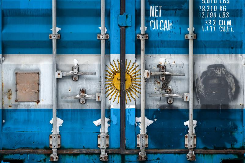 The concept of export-import and national delivery of goods. Close-up of a container with the national flag of Argentina. The concept of Argentine export-import royalty free illustration