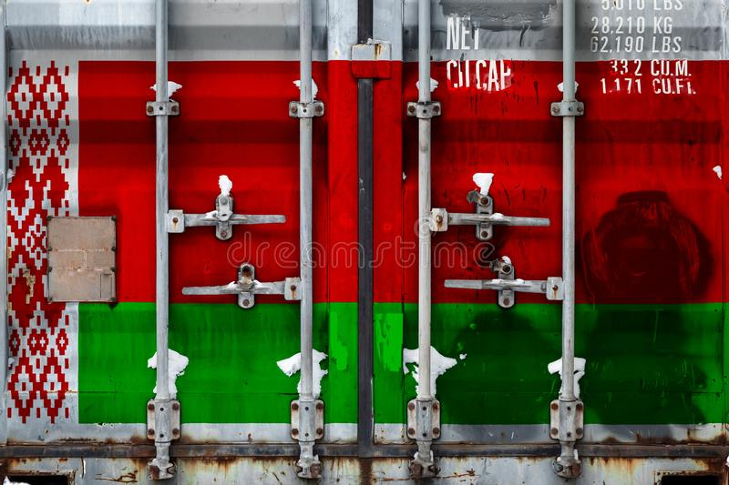 The concept of export-import and national delivery of goods. Close-up of the container with the national flag of Belarus. The concept of the Belarusian export royalty free illustration