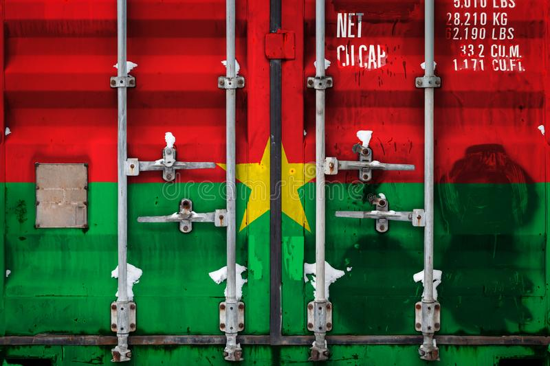 The concept of export-import and national delivery of goods. Close-up of the container with the national flag of Burkino Faso. The concept of export-import of stock illustration