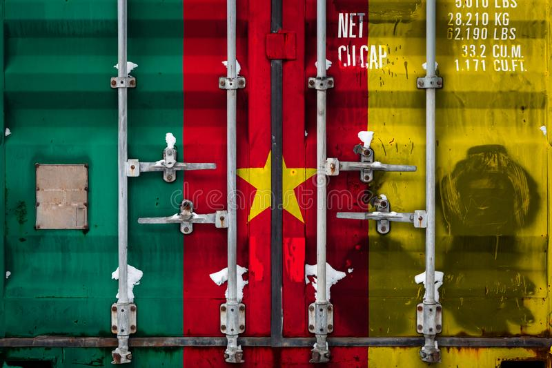 The concept of export-import and national delivery of goods. Close-up of container with national flag of Cameroon. The concept of export-import Cameroon and vector illustration