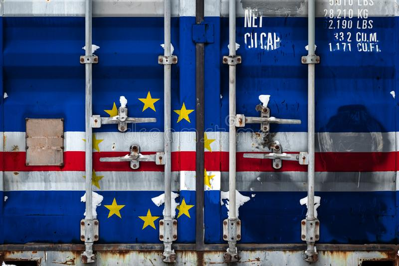 The concept of export-import and national delivery of goods. Close-up of container with national flag of Cape Verde. The concept of export-import Cape Verde and stock illustration