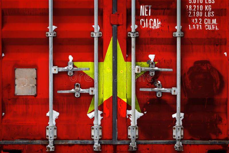 The concept of export-import and national delivery of goods. A closeup of a container with the national flag of Vietnam. The concept of export-import Vietnam and royalty free illustration