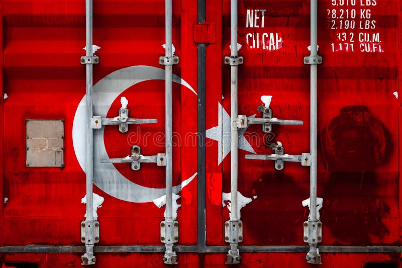 The concept of export-import and national delivery of goods. A closeup of a container with the national flag of Turkey. The concept of export-import Turkey and royalty free illustration