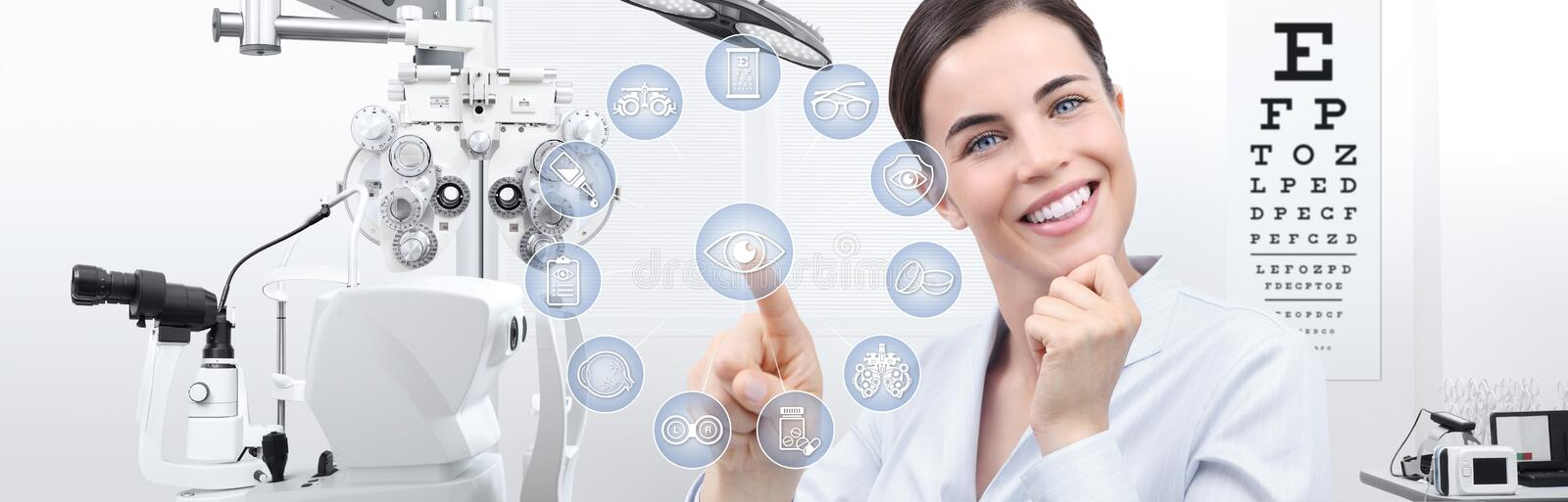 Concept of eye examination, smiling woman touch screen with icons in optometrist office, optician diagnostic equipments. On background stock photography