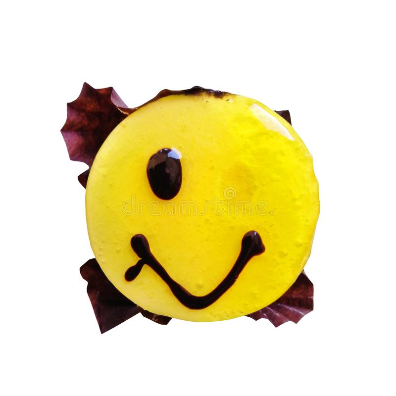 The concept of a failed diet, surprise. Funny sweet smilie, round yellow jelly cake, dessert for good mood stock photos