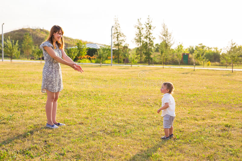 Concept of family - mother and child son outdoors in summer stock image