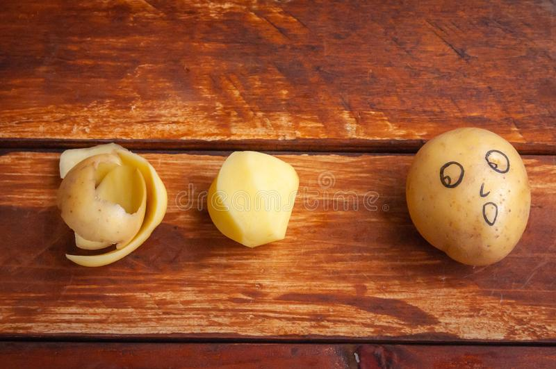 Concept of fear of being undressed. A potato with a painted face looks at the naked potato in surprise. concept of fear of being undressed. fear of nudism royalty free stock images
