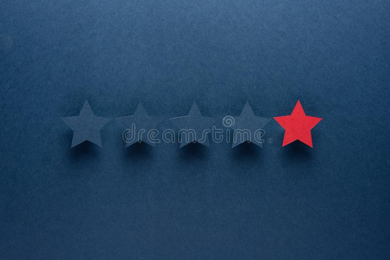 The concept of feedback or excellence is different from everyone, be the first. The red star stands out against the blue royalty free stock photography