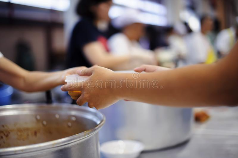 Concept of Feeding : Helping People With Hunger With Kindness royalty free stock photography