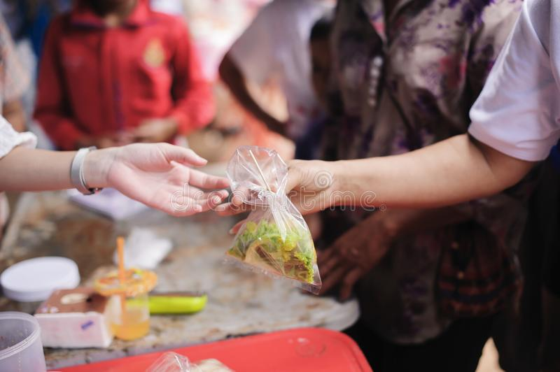 Concept of feeding : Sharing food with people in poor communities : the concept of sharing help to fellow human beings in society.  stock photography