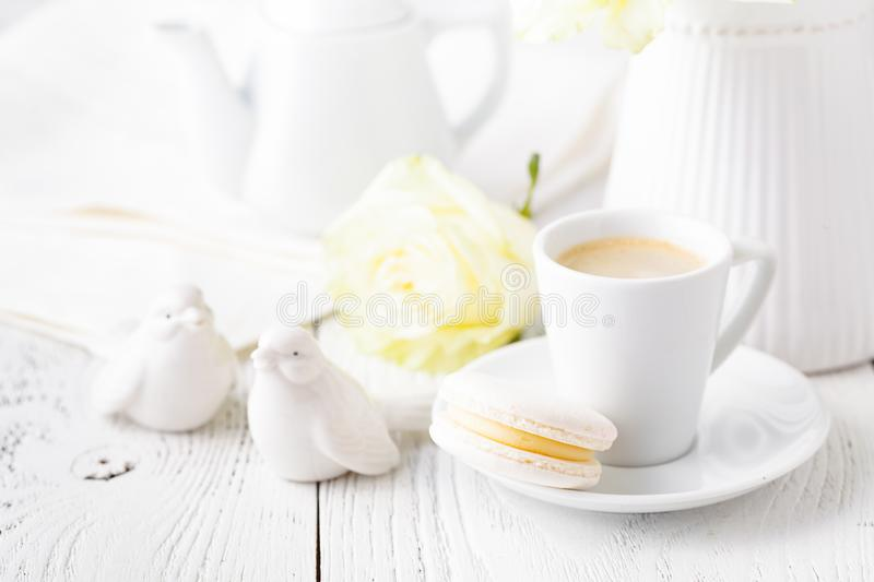Concept of female morning table with cup of coffee on table close up stock image