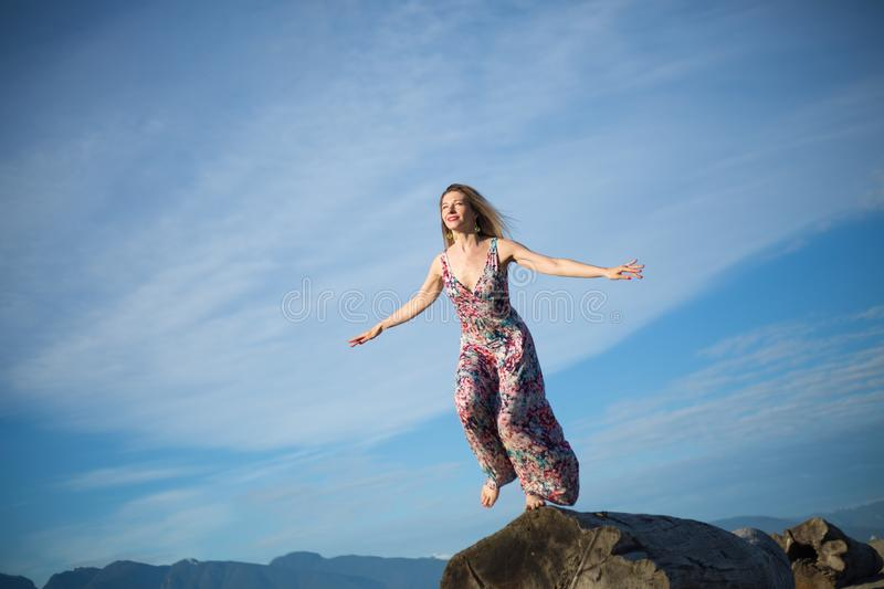 Concept feminine confidence young woman ready to fly royalty free stock images