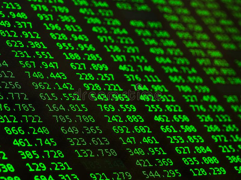 Concept of Financial data on a monitor. Display of Stock market quotes on black background royalty free stock photos