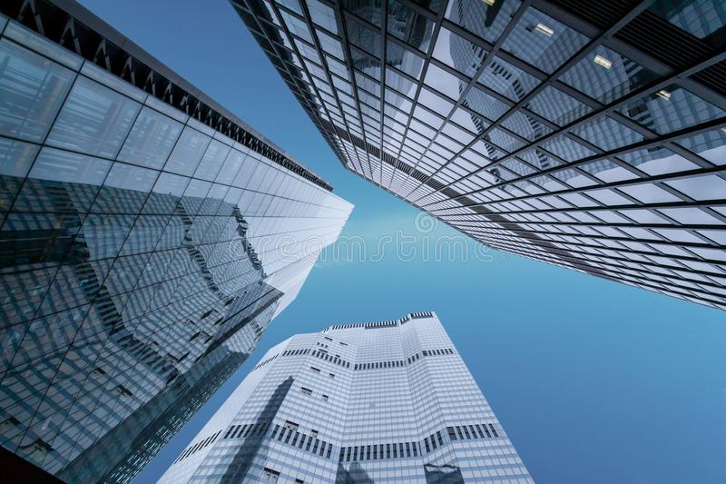 Concept of financial economics future. Low angle view of tall corporate buildings royalty free stock images