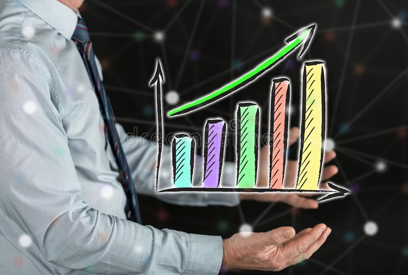 Concept of financial growth. Financial growth concept above the hands of a man stock photography