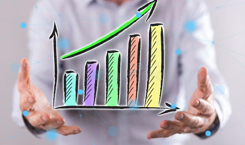 Concept of financial growth. Financial growth concept above the hands of a man in background stock images