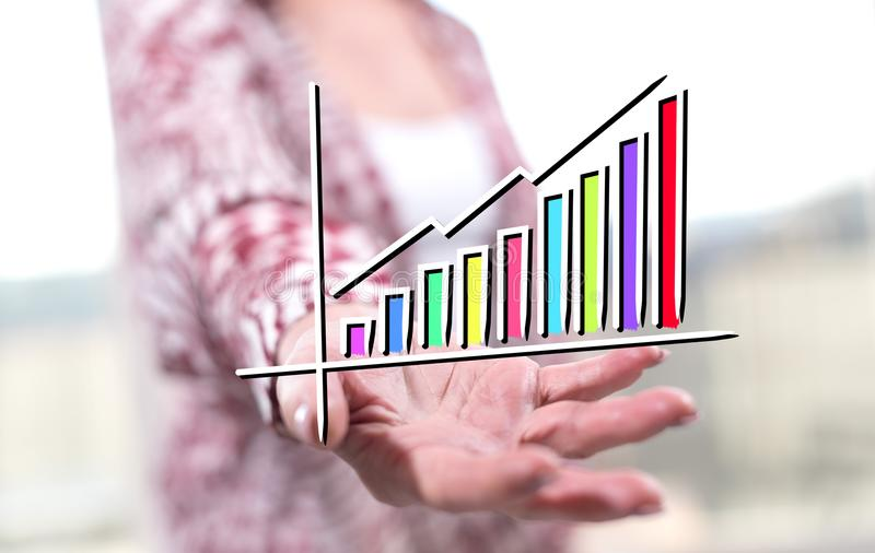 Concept of financial growth. Financial growth concept above the hand of a woman in background royalty free stock photography