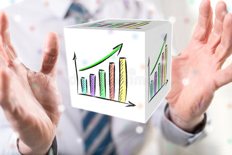 Concept of financial growth. Financial growth concept between hands of a man in background stock photo