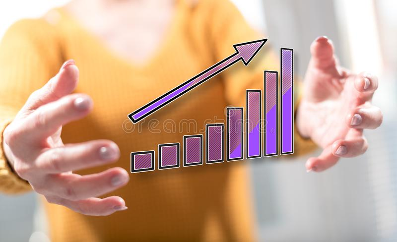 Concept of financial growth. Financial growth concept between hands of a woman in background stock image