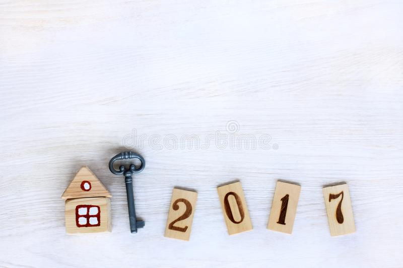 Individual housing in 2017. Concept finished house with a key, and digits on wooden plates denoting year stock images