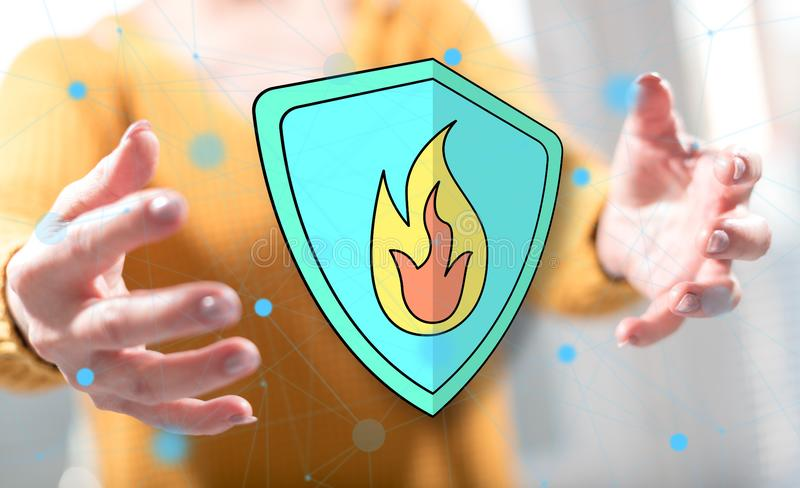 Concept of fire protection. Fire protection concept between hands of a woman in background stock photo