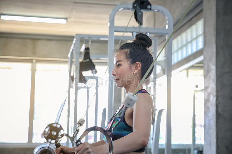 Concept fitness sport training lifestyle. Asian women who are committed to weight control. Exercise in the gym or sports club stock photo