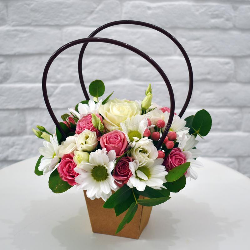 Flower composition in original hatbox. Beautiful flowers in stylish hat box stock image