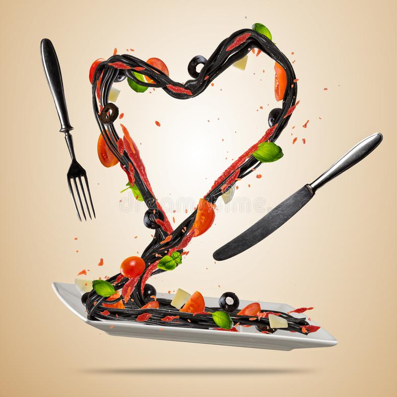 Concept of flying italian food in heart shape royalty free stock image