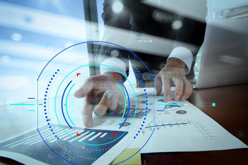 Double exposure of business man hand working on blank screen lap. Concept of focus on target with digital diagram.Double exposure of business man hand working on stock photo