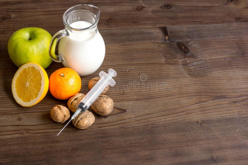Concept food allergies on wooden background. Close up royalty free stock images