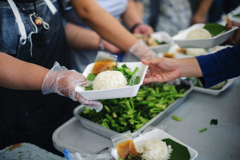 Concept of food sharing for the poor to alleviate hunger : Social Problems of Poverty Helped by Feeding : Donate food to people in royalty free stock photography
