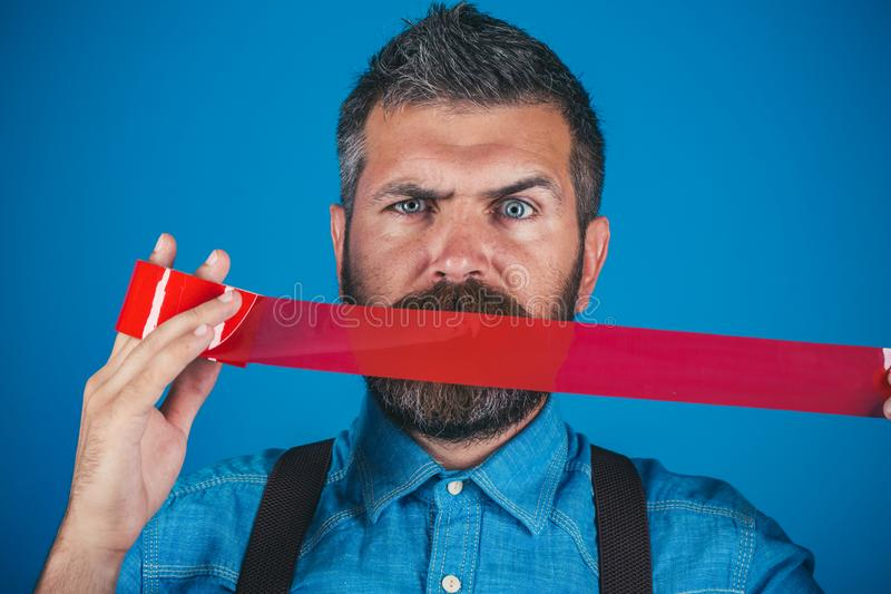 Concept freedom of speech and press. man wrapping mouth by adhesive tape. Mind control and propaganda. International. Human Right day. censorship. Brutal royalty free stock photo