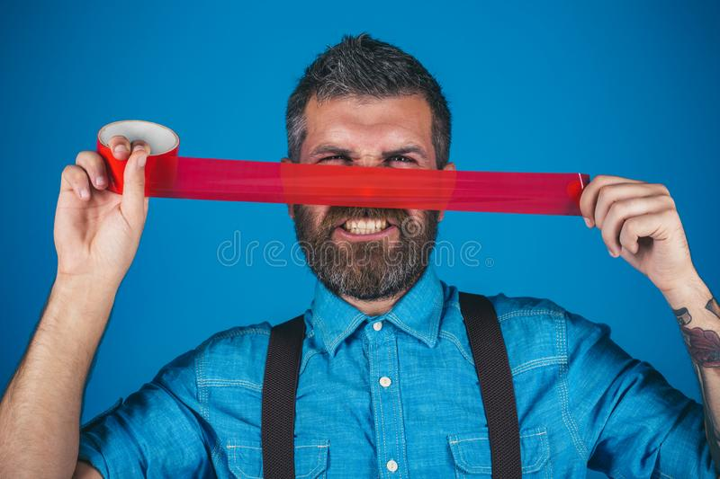 Concept freedom of speech and press. man wrapping mouth by adhesive tape. Mind control and propaganda. International. Human Right day. censorship. Brutal royalty free stock images