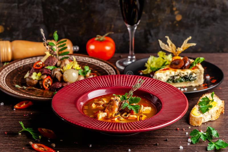 Concept of French cuisine. Laid table in a restaurant for a celebration of different dishes. background image. Copy space royalty free stock photos