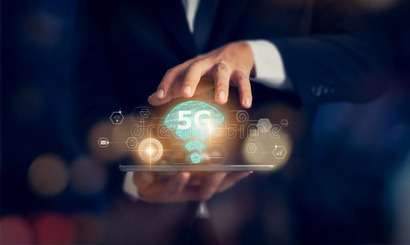 Concept of future technology 5G network, businessman hands holding tablet and high-speed new generation networks screen interface. stock photos