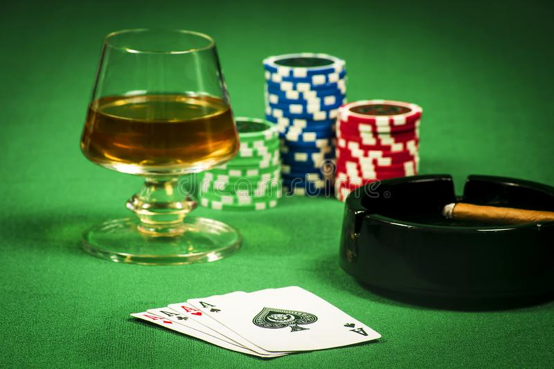 The concept of gambling, cards and chips with a glass of cognac and a cigar stock images