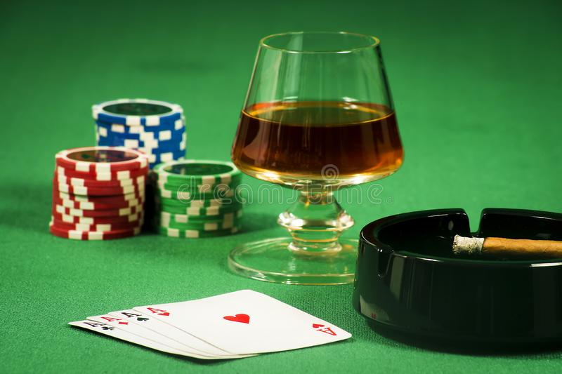 The concept of gambling, cards and chips with a glass of cognac and a cigar stock photos