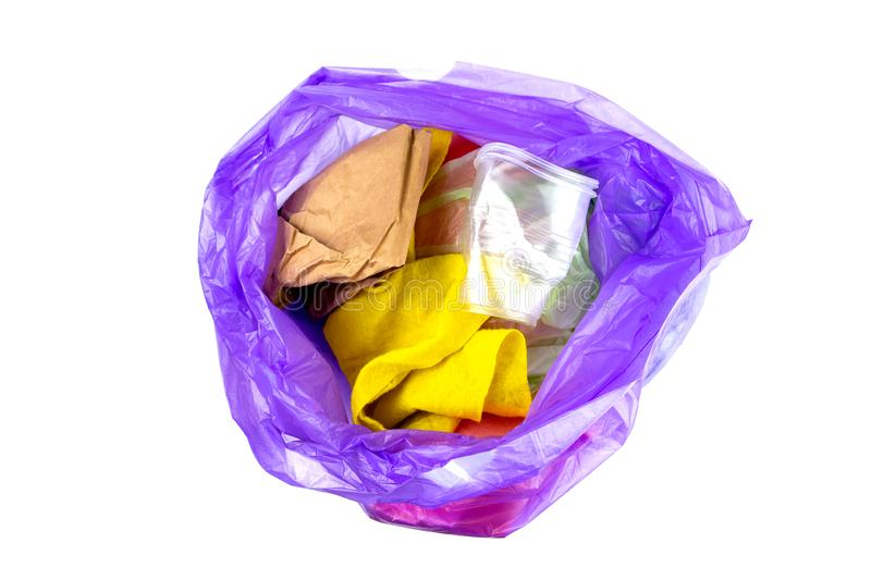 Concept of garbage and pollution. A pile of trash, crumpled plastic cup, packages, paper isolate on a white background royalty free stock photo