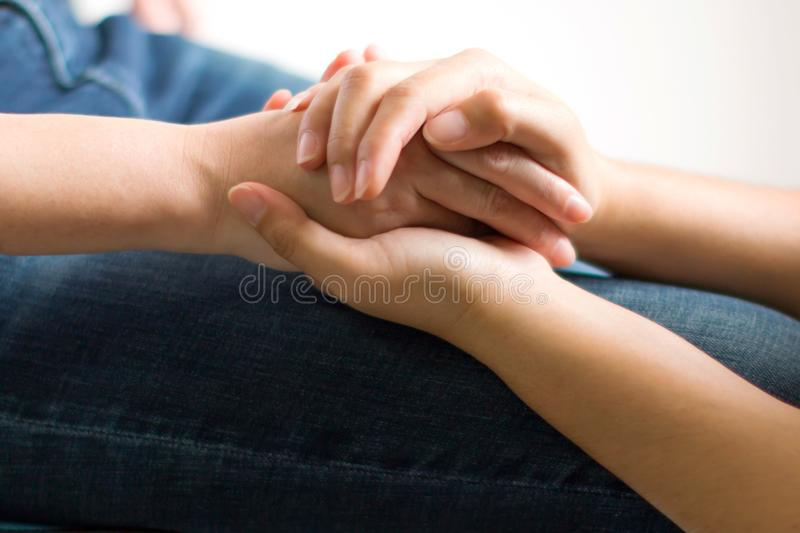 Concept of giving support and spirit. Close-up of one person holding hands for give more hope and spirit to another royalty free stock photography