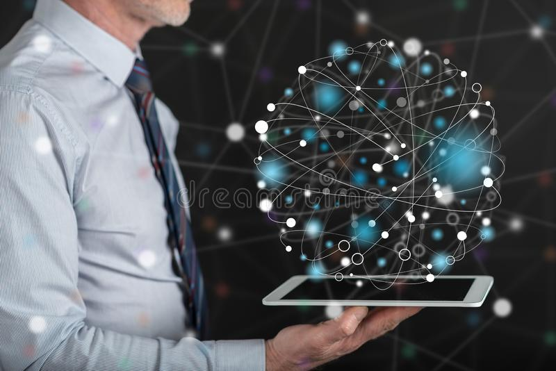 Concept of global connection. Global connection concept above a tablet held by a man stock image