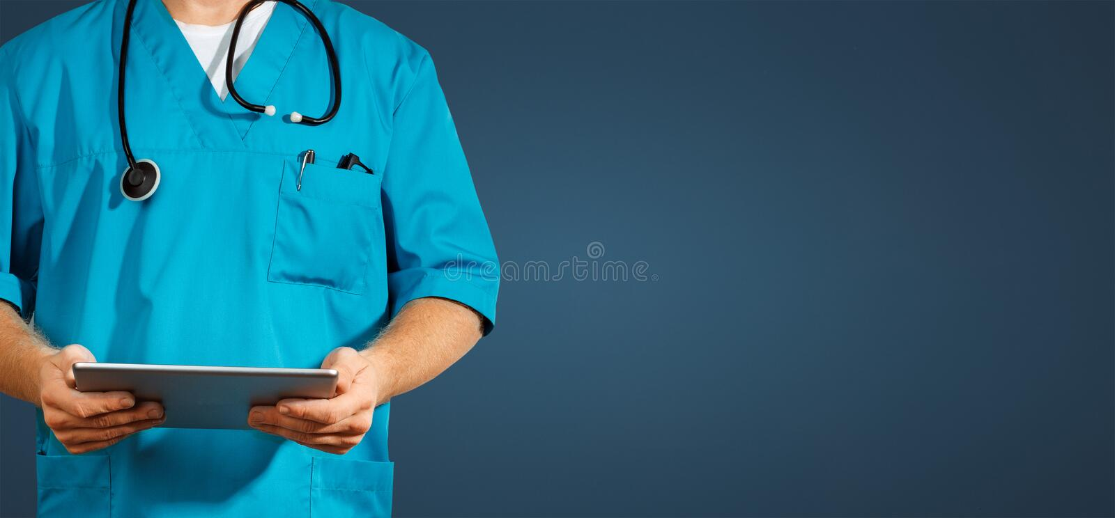 Concept of global medicine and healthcare. Unrecognizable doctor using digital tablet. Diagnostics and modern technology on blue. Concept of global medicine and stock image
