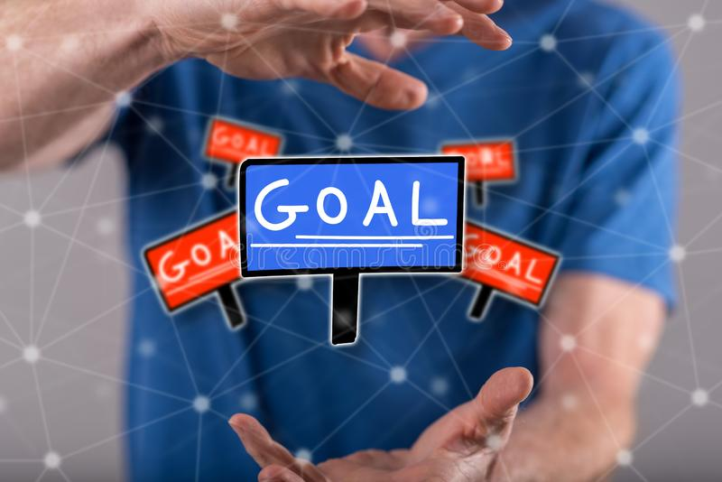 Concept of goal. Goal concept between hands of a man in background royalty free stock photos