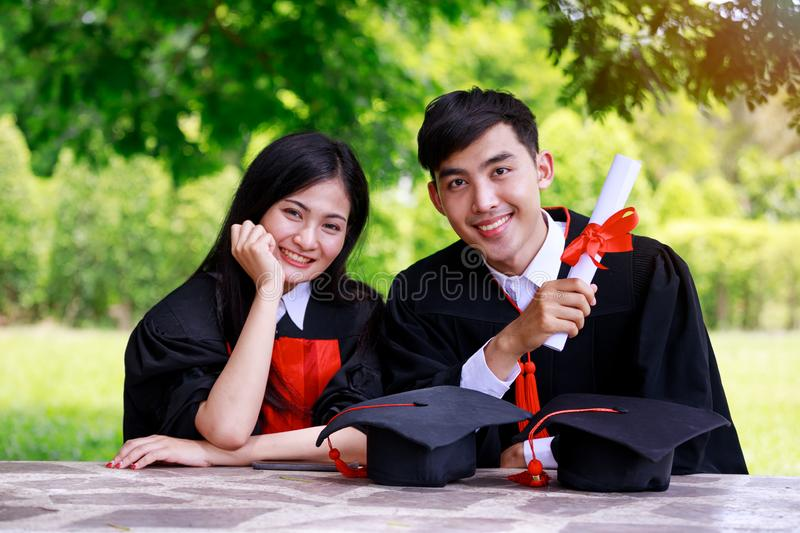 Concept of Graduated beautiful young Asian student with friends wearing a graduation suit royalty free stock photo
