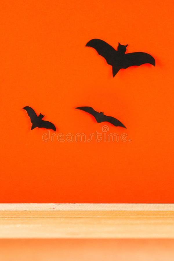 The concept for Halloween. Bats on orange background royalty free stock images