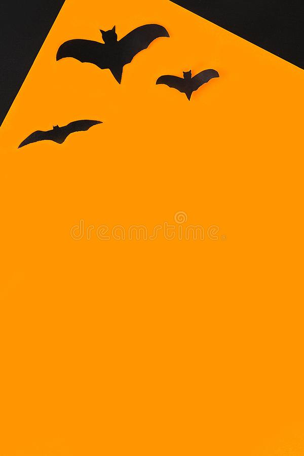 The concept for Halloween. Bats on orange background stock photos